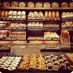 if we want to do more bread sales at bakery we could have a bread display wall separating the kitchen from the retail space. Bakery Store, Bakery Cafe, Cafe Restaurant, Restaurant Design, Bread Display, Bakery Display, Display Case, Display Ideas, Bakery Shop Design