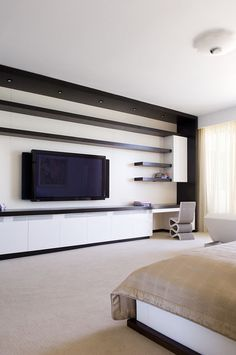 modern bedroom by Pepe Calderin Design- Miami Modern Interior Design - speakers attach to sides of TV