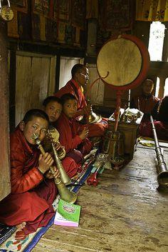 Monks playing traditional sacred music - Bhutan