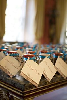 Our cute favors for this indian wedding were little spice jars with family recipes on them.  The hand calligraphered names also allowed them to serve as butler cards as well.