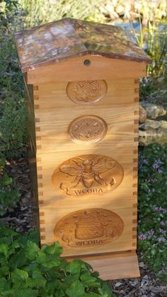 Carved honey bee hive