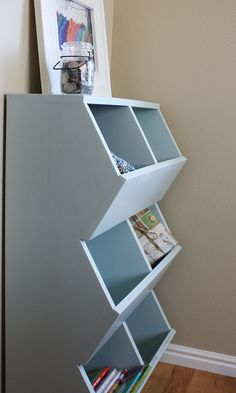 PLEASE NOTE: This listing is for woodworking plans (instant download) and not for the completed item. There are no refunds on downloaded woodworking plans.    Make these sturdy toy storage bins with our woodworking plans. The shelf has 6 bins to organize and store toys in the playroom but can also be used in a mudroom, pantry, entryway, garage, etc. for many other things in your home including:    - books  - clothing and shoes  - garden tools  - craft supplies  - games  - sporting equipment…
