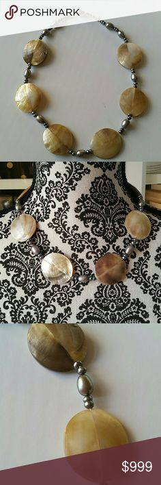 Vintage Freshwater Pearl Mother of Pearl Necklace Vintage  This item came from a High End Palm Beach Estate.  This was her travel jewelry and/or costume jewelry.    Dark Gray iridescent to purples and blues freshwater pearls of varying size 6 Larger pieces of mother of pearl throughout  Length -   Clean smoke free home Vintage Jewelry Necklaces