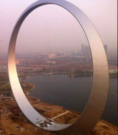 """The enormous monument """"Ring of Life"""" in Fushun, Liaoning Province in China, a meters) high metal structure, serving as an elevated sighting site. Ring of Life a monument is made of tons of steel, uses four elevators to and glows at night by LED lights. Architecture Design, Chinese Architecture, Futuristic Architecture, Beautiful Architecture, Contemporary Architecture, Monumental Architecture, Creative Architecture, Contemporary Building, Architecture Wallpaper"""