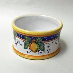 """4.25""""D x 2.5""""H  Place your wine bottle in this decorative hand-painted lemon motif Italian ceramic coaster. Try pairing with our other Italian dishware pieces, such as the wine cups, U6/11A. This coaster also makes a great gift by itself or paired with a bottle of wine."""