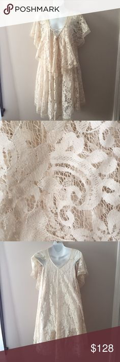 """Free people ivory lace dress. Size Small Excellent condition Free people ivory lace dress. Size Small. 40"""" long.  Crossover lace front accents. Lace is nylon. Cotton lining. Free People Dresses"""