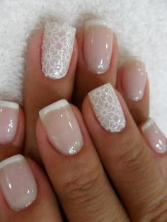 Elegant classic French manicure is made with a reshaping of a nail bed. It is supplemented by a cellular appliqués on the ring fingers. Such gel manicure is long worn, and the neutral color combination allows you to combine it with any style of dress. Delicate, stylish but low-key it can adorn even the fingers of a bride on a wedding day.