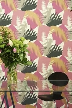 Deco Palm Wallpaper A spectacular wallpaper with a palm motif screen printed in shades of green on an off-white ground. The design, which is inspired by the exotic foliage found in Miami, has been worked into a more contemporary geometric style that takes the palm to new and exciting heights.