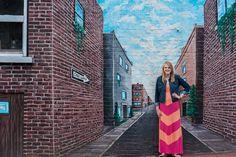 Senior Portraits Asheville, NC| Fun senior portrait downtown asheville in front of city mural| Kathy Beaver Photography