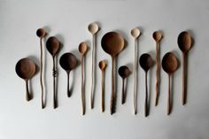 hand-carved walnut wooden spoons by Ariele Alasko, site shows carving out bowl of spoon before cutting out the outline of the spoon. This would give greater stability during the carving.