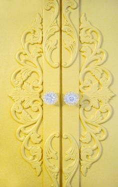 A Pair of Yellow Doors with Glass Handles ....