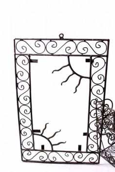 La chapelle de la Lorette      Miroirs, cadres   Cadre contours soleil en fer forgé La chapelle de la Lorette      Miroirs, cadres   Cadre contours soleil en fer forgé Boutique artisanat marocain, Vente artisanat marocain, artisanat du Maroc : Chapelle de la Lorette