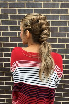 another angle on this adorable dutch braided ponytail hairstyle from our holiday photoshoot | hair by goldplaited