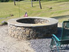 Backyard fire pit~I like the caps on this pit. Makes it look clean and finsihed.
