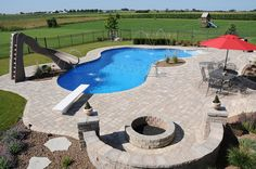 Natural lagoon vinyl in ground pools go great with fire pits and water features by aspools, via Flickr