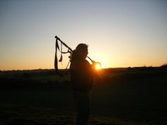 This photo of John O'Boyle was taken at the Beltane celebrations at Thornborough Henge in North Yorkshire after John's wife asked him to play his pipes for the setting sun. The sound of the pipes made the occasion extra special for those in attendance, and there's now a legend that a piper has played the sun down of Beltane at Thornborough for thousands of years!