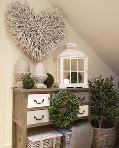 Extra large twig heart..complimented by a large white lantern and grey acorns... Www.westbarninteriors.co.uk