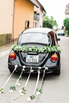 Just married car! http://www.stylemepretty.com/little-black-book-blog/2015/01/15/romantic-germany-barn-wedding/ | Photography: Ashley Ludaescher - http://ashleyludaescher.com/