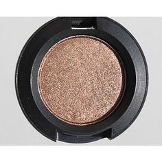 MAC Eyeshadow in Tempting.  Just the right amount of shimmer for summer, perfect for blue eyes.