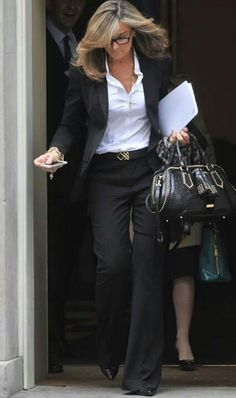 Angela Ahrendts in a chic black suit with white button down and fashion forward accessories.