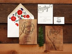 Floral envelope liners with rustic wood-inspired invitations done by A Milestone Paper Co.