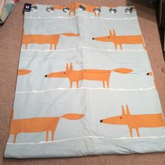 SOLD. Single curtain - Lined & Interlined. Description: Duck egg blue with foxes. Width: 1.79m Drop: 2.3m Heading: Eyelet Contact:The Curtain Bureau for price & availability. T: 07799887719 Info@thecurtainbureau.com CODE: A/76/1114 Char