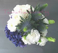 Styled with hydrangeas,  lisianthus, woody bushes and other accents.