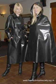 Black Rubber Raincoat & Cape at a Mackintosh Society function.