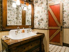 Love the wallpaper in this rustic bathroom.