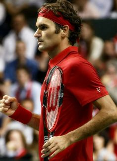 A 'vision in red' Roger wins his Davis Cup match (from Twitter, no credit given for photo)