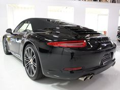 The 2015 Porsche 911 Carrera S Cabriolet featured here is finished in stunning all black with a beautiful black leather interior. It has been driven just 4,032 miles and is equipped with nearly every desirable...