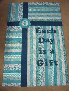 """This is an Ovarian Cancer """"Gift"""" Quilt, I have designed to help support my friends daughter who is one her 3rd round of ovarian cancer....I saw several quilts similar to this on the internet but could never find a pattern.. so I made my own. Check out all the other cancer awareness items on my website www.appliquesquiltsandmore.com"""