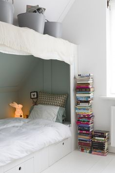 Stack of books in this white girls room | Styling Jessica Bouvy | Photographer Dana van Leeuwen | vtwonen April 2014
