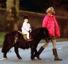 British Shetland  Princess Diana gives a young William a lead on his Shetland pony.