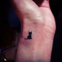 My kitty cat tattoo! I think behind the ear in honor of my late baby black kitty…