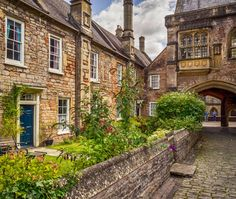 Beautiful terraced cottages in the ancient city of Wells, Somerset, England, once used by visiting clergy of the nearby cathedral.