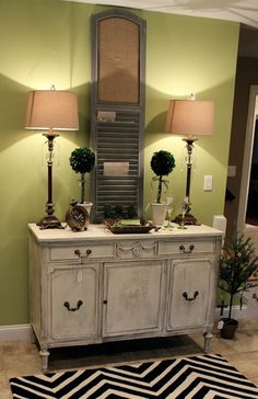 A vintage server gets styled with HomeGoods lamps, rug and topiaries by Maison Decor #sponsored #homegoodshappy
