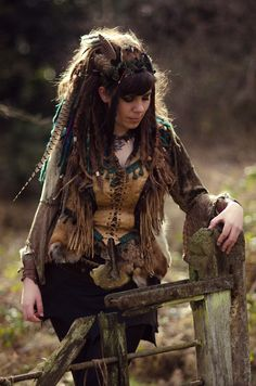 I love the details in her hair, especially the almost hidden pops of color.  Found on www.mylarpcostume.com