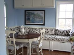 DIY IKEA banquette with drawers using over-the-fridge cabinets and drawer hardware.