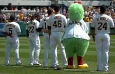 Pirates lose to Brewers Sunday-the Pirate Parrot sings the national anthem with the starters before the game.