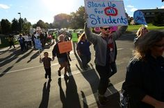 GOLDEN, CO - OCTOBER 2: Hundreds of Jefferson county students, teachers and parents took to the streets for a rally to protest the curriculum review