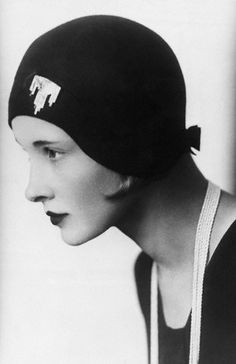 love the cloche hat with the deco pin, 1920s