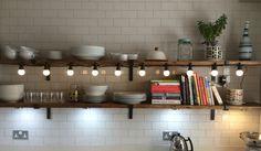 Open kitchen shelves with festoon lights