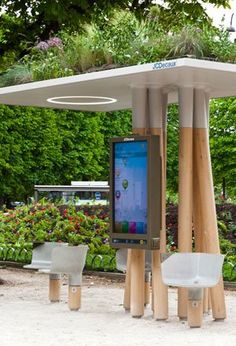 I like the way the digital display is mounted on the collection of poles...they look tree-like. (A Natural Wi-Fi Station in Paris | Sustainable Cities Collective)