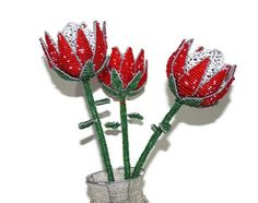 Red Green, White beads and Wire. Unique Wedding Gifts, Unique Weddings, South African Design, King Protea, Protea Flower, African Artwork, White Beads, Circle Design, Beads And Wire