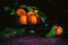 Still life of tangerines by The baking man on @creativemarket