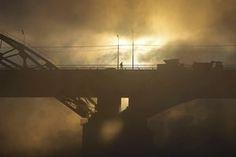 Moscow, Russia: A man walks on a bridge