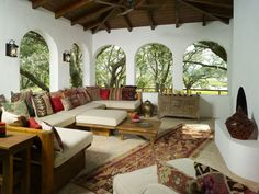 """I LOVE this outdoor space.  Not possible in the AZ desert with so many """"critters"""" willing to hide in all those cushions!  mediterranean porch by Summerour Architects"""