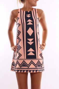Asymmetrical because of the patterns on the dress. The shape of the dress is symmetrical. The Aztec pattern has slight differences that make it asymmetrical. Scoop neck with thick straps. Straight and above the knee.