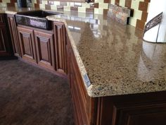 Silestone Sienna RIdge. Dark wood kitchen cabinets.